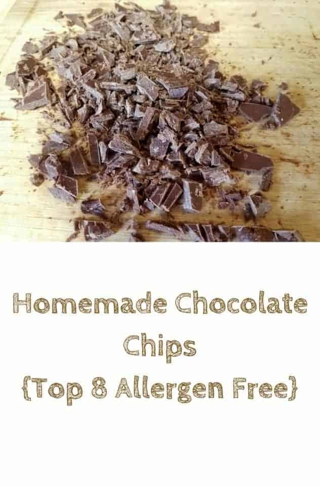 A large pile of homemade chocolate chips sit on a light colored wooden cutting board. This is the designated pinterest pin.