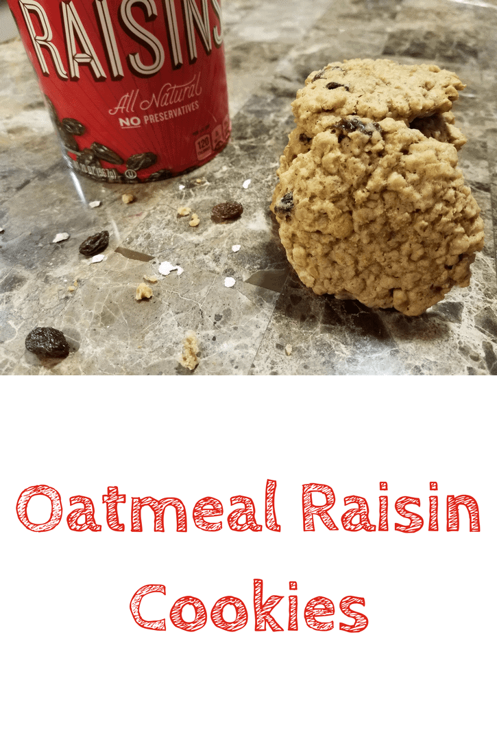 A stack of oatmeal raisin cookies sitting on a fake marble top dinning room table with the container of raisins in the background. Sprinkled on the table around the cookies are raisins, bits of cookie, and uncooked oats. This is the designated pinterest pin.