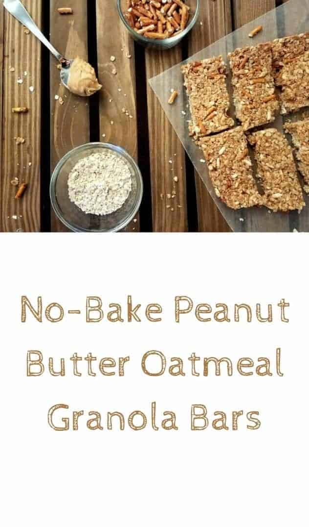 No-bake peanut butter oatmeal granola bars sit on a piece of wax paper on a dark wood plank background. Adjacent to the bars is a spoon with a scoop of peanut butter, a small glass bowl of pretzels, and a small glass bowl of oats. Oats and pretzel pieces are sprinkled about. This is the designated pinterest pin.