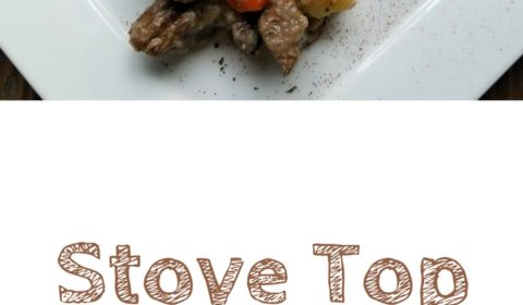 Stove top beef stew with a sweet potato biscuit on a white square plate. This is the designated pinterest pin.