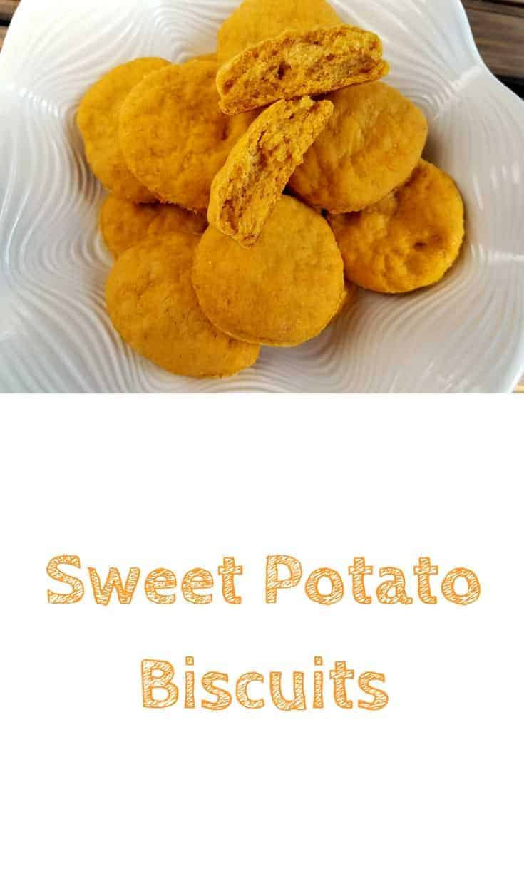 A pile of sweet potato biscuits sitting in a large white fluted bowl. This is the designated pinterest pin.