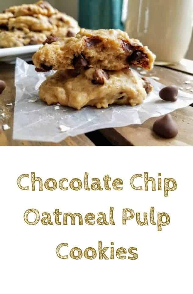 Chocolate chip oatmeal pulp cookies rest on a square of wax paper atop a dark wood plank background. In the background is a plate full of cookies and a glass of homemade oat milk. Sprinkled about are chocolate chips and raw oats. This is the designated pinterest pin.