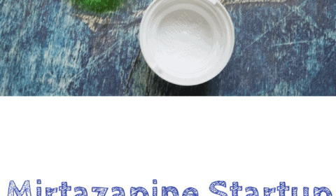 A pill cutter sits next to a pill bottle of mirtazapine tablets spilled out onto a blue background. This is the designated pinterest pin.