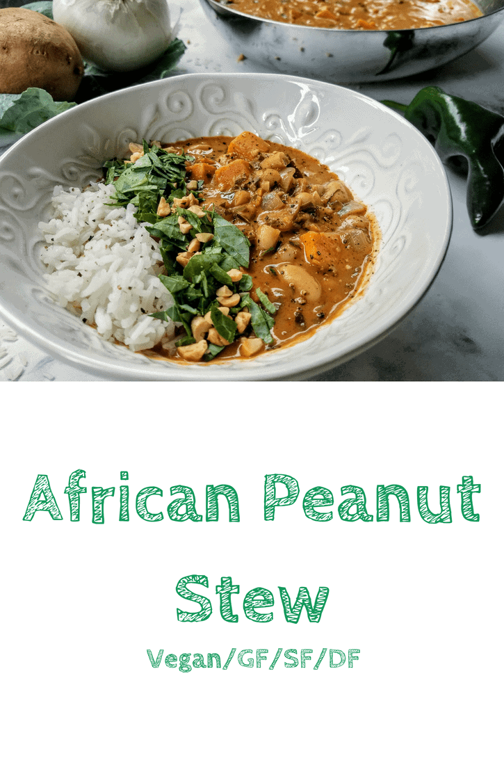 African peanut stew in a small decorative white bowl. In the background is an onion, sweet potato, collard greens, poblano pepper, and a stainless steel frying pan containing the stew. The bowl of stew is topped with a vertical line of jasmine rice on the left side, and a vertical line of chopped collard greens and peanuts next to it. This is the designated Pinterest pin.