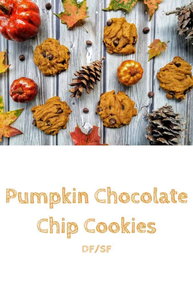 A collage of pumpkin chocolate chip cookies, pine cones, chocolate chips, leaves, and artificial pumpkins on a wood plank background. This is the designated pinterest pin.
