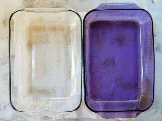 "Salted eggplant slices are sandwiched between layers of paper towels to sweat. Two glass 9"" x 13"" pans sit on top to provide weight and squeeze out excess moisture."