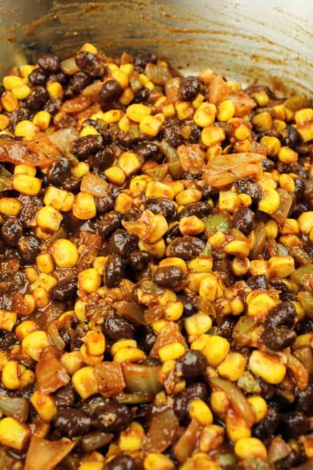 Corn, black beans, and tomato sauce mixed in with the onion, garlic, cubanelle pepper, and spices.