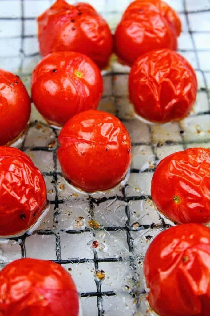 Roasted cherry tomatoes at the halfway mark.