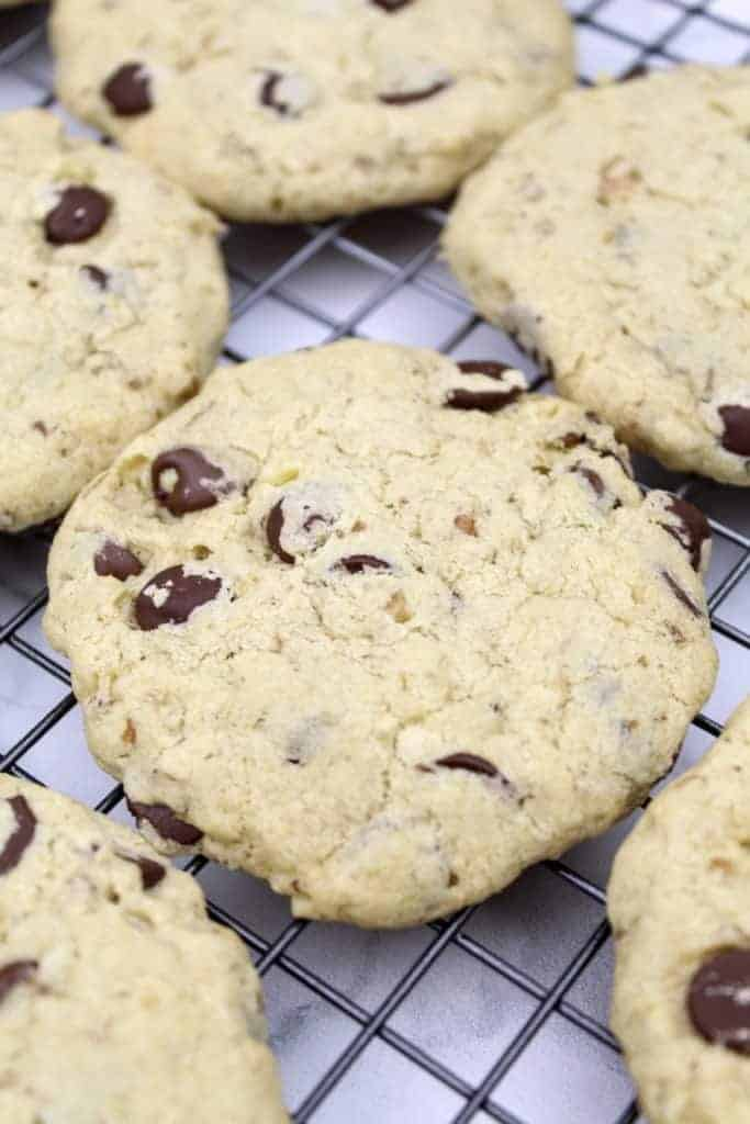 Baked vegan doubletree chocolate chip cookies sit on a cooling rack.
